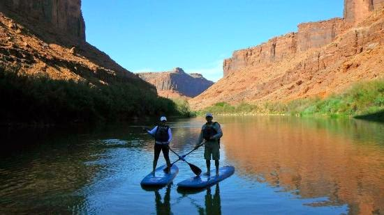 Paddle boarder in the Grand Canyon Colorado River
