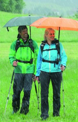 couple with trekking umbrellas
